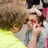 Nailyn Laboy, 5, gets her face painted by Jennifer Davis during the HealthAlliance Hospital's Family Day event on Saturday morning. SENTINEL & ENTERPRISE / Ashley Green