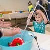 Ava Tuttle, 4, uses surgical tools on a red pepper at the laproscopic table with the help of Angelica Perez during the HealthAlliance Hospital's Family Day event on Saturday morning. SENTINEL & ENTERPRISE / Ashley Green
