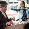 Senator Jen Flanagan (background) has a laugh as Fitchburg Mayor Steve diNatale reads a letter from former Fitchburg Mayor Peter Levanti found in a time capsule buried in the old Bullock Building at Burbank Hospital SENTINEL & ENTERPRISE / Jim Marabello