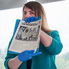 Kelli Rooney of Health Alliance holds up 'The Burbank Newsbank' from June 1953 during the opening of a time capsule found during demolition of the Bullock Building at Burbank Hospital. SENTINEL & ENTERPRISE / Jim Marabello