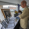 Attendees at a time capsule opening at Burbank Hospital look over portraits of historic doctors and members of the hospital. SENTINEL & ENTERPRISE / Jim Marabello