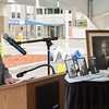 Kathy Flynn of the Fitchburg Historical Society talks about the history of the hospital including Richard Bullock, pictured in the large photo duirng a time capsule opening and groundbreaking cerremony at Burbank Hospital. SENTINEL & ENTERPRISE / Jim Marabello