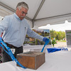 Dave Bilotta, Director of Facilities for Health Alliance opens a time capsule discovered during demolition of the Bullock Building at Burbank Hospital. SENTINEL & ENTERPRISE / Jim Marabello