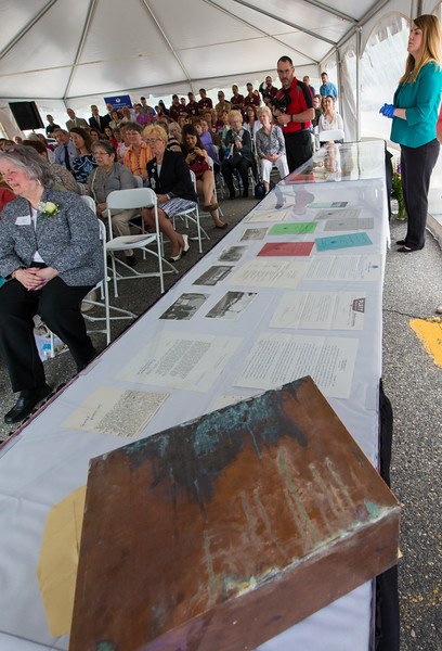 A time capsule discovered in the Bullock Building of Burbank Hospital sits in the foreground with the assorted papers found in it arrayed under plexiglass in the background during a ceremony and groundbreaking at the hospital. SENTINEL & ENTERPRISE / Jim Marabello