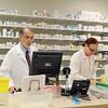Pharmacist Mike Dow and Pharmacy Tech Carmen Crus Rivera work in the new pharmacy in the now open Fitchburg Family Health Center. SENTINEL & ENTERPRISE/JOHN LOVE