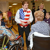 Boston Bruins national anthem singer Rene Rancourt greets residents during the ribbon cutting ceremony for the Gardner Rehabilitation and Nursing Center on Wednesday afternoon.  SENTINEL & ENTERPRISE / Ashley Green