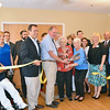 Residents, administrators and employees cut the ribbon during a ceremony for the Gardner Rehabilitation and Nursing Center on Wednesday afternoon.  SENTINEL & ENTERPRISE / Ashley Green