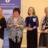 Susan LeBouf, Chaplain Catherine Pimley, Karen Flynn and Vanessa DaCunha receive awards during the HealthAlliance Hospital Champions of Excellence Awards ceremony at the DoubleTree by Hilton Hotel on Wednesday. SENTINEL & ENTERPRISE / Ashley Green