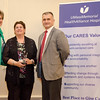 Patricia Normandian receives an award from CEO and President Deborah Weymouth and Bob Dullea during the HealthAlliance Hospital Champions of Excellence Awards ceremony at the DoubleTree by Hilton Hotel on Wednesday. SENTINEL & ENTERPRISE / Ashley Green