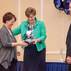 Rachel Johnson receives an award from CEO and President Deborah Weymouth during the HealthAlliance Hospital Champions of Excellence Awards ceremony at the DoubleTree by Hilton Hotel on Wednesday. SENTINEL & ENTERPRISE / Ashley Green