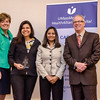 The Hospitalist Team, represented by Ximena Castro and Binu Pathrose receives an award from CEO and President Deborah Weymouth and Paul MacKinnon during the HealthAlliance Hospital Champions of Excellence Awards ceremony at the DoubleTree by Hilton Hotel on Wednesday. SENTINEL & ENTERPRISE / Ashley Green