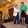 The Executive Nursing Practice Committee Team receives an award from CEO and President Deborah Weymouth during the HealthAlliance Hospital Champions of Excellence Awards ceremony at the DoubleTree by Hilton Hotel on Wednesday. SENTINEL & ENTERPRISE / Ashley Green