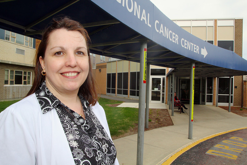 Kerry Beaulac an oncology nurse at Simond-Sinon Cancer Center is warried about looming cuts to the center, as well as HealthAlliance Hospital Burbank Campus' urgent care facility. SENTINEL & ENTERPRISE/JOHN LOVE