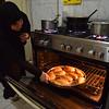 Fatma Abdel Hady bakes stuffed bread for an order.  - 30 January 2017 - Cleopatra area - Alexandria, Egypt
