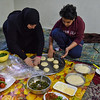 Fatma Abdel Hady Fatma stuffing dough with mixed ingredients while her 12 years old son helps her. - 30 January 2017 - Cleopatra area - Alexandria, Egypt