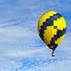 Football-shaped racing balloon gliding gracefully.