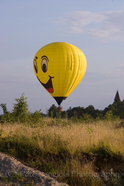 """""""Smile High"""" hot air balloon over Pinkerton Academy in Derry, NH"""