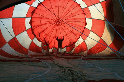 Inside view of a hot air ballon and silhouetted figures