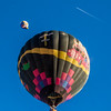 Modern jet and venerable hot air balloons sharing the sky above Durango