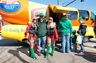 Everyone wants to be photographed with the Wienermobile. Even the Budweiser girls. Beer and hot dogs. Yum!