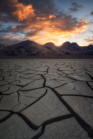 Sunrise over mud cracks in Death Valley, California