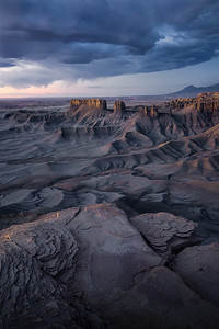 Pre-morning light glows across Utah's southern badlands