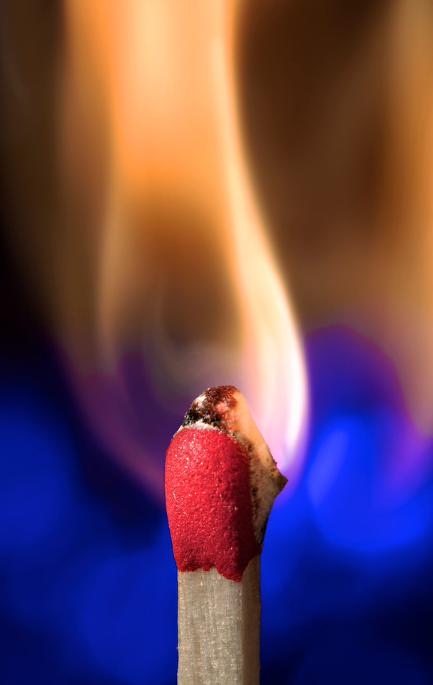 """Ignition!<br /> by John Gasca<br /> <br /> 2nd Place in the """"Close Up"""" Saddleback Challenge 2010.<br /> 2nd Place in """"The Next Level"""" community (Close Up / Macro) competition of Inspire 2011: <a href=""""http://inspi.re/"""">http://inspi.re/</a><br /> Honerable Mention in the 2011 OC Fair Fine Arts Photography Exhibit.<br /> <br /> Details: Lit with a 580EXII 1/4 power camera left. Strobe was snooted and gelled with a full CTO. Triggered with pocket wizard TT5. Background lit with a blue LED penlight reflecting off of aluminum foil. The lighting setup can be found here:<br /> <br /> <a href=""""http://video-line.smugmug.com/Hot-Off-the-Sensor/Lighting-Setups/14257778_pQ5yU#1132975923_a6gvM"""">http://video-line.smugmug.com/Hot-Off-the-Sensor/Lighting-Setups/14257778_pQ5yU#1132975923_a6gvM</a>"""