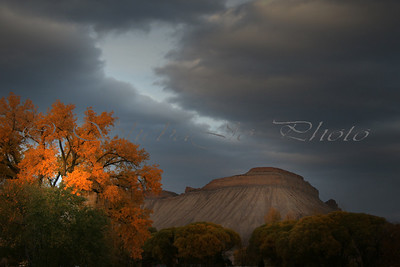 Cloudy, fall sunset and Mt Garfield,