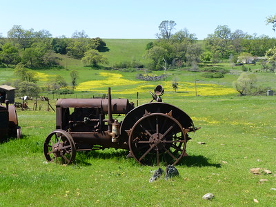 Photographer's name: Jerry Fuller ______________________________________________________________________ Who is in the photo? Old farm tractor and wildflowers ______________________________________________________________________ What is happening in the photo? scenice ______________________________________________________________________ Date photo was taken 04-01-2016      Cherokee Road near Table Mountain