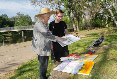 Butte College painting teacher Julie Shaw talks with her student Eli Myers about his painting while the class is on a painting field trip at Five Mile Wednesday April 13, 2016 in Chico, Calif. (Emily Bertolino -- Enterprise-Record)