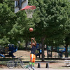 Toan Tran who grew up in Fitchburg and now lives in Minnesota did not let the heat bother him as he shots some baskets at Green Street Park in Fitchburg on Thursday as the temperatures reached the low 90's. Tran was home visiting family and friends. SENTINEL & ENTERPRISE/JOHN LOVE