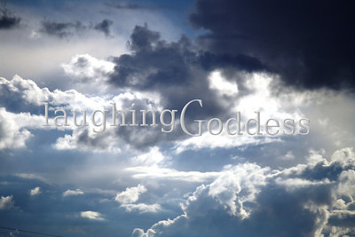 Title: Cloudy Sunlight breaking through the clouds.