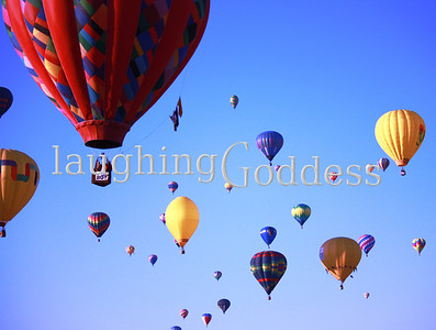 Title: Fiesta Brightly colored hot airs float across the sky at the Albuquerque Hot Air Balloon Festival.