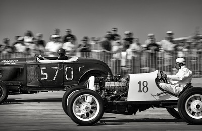 In a match race of the V8 and banger class winners, Michael Santiago, of Vernon, WA #18 in his homemade speedster races Scott McCann of CO in his 1932 Roadster. Santiago took the overall victory.