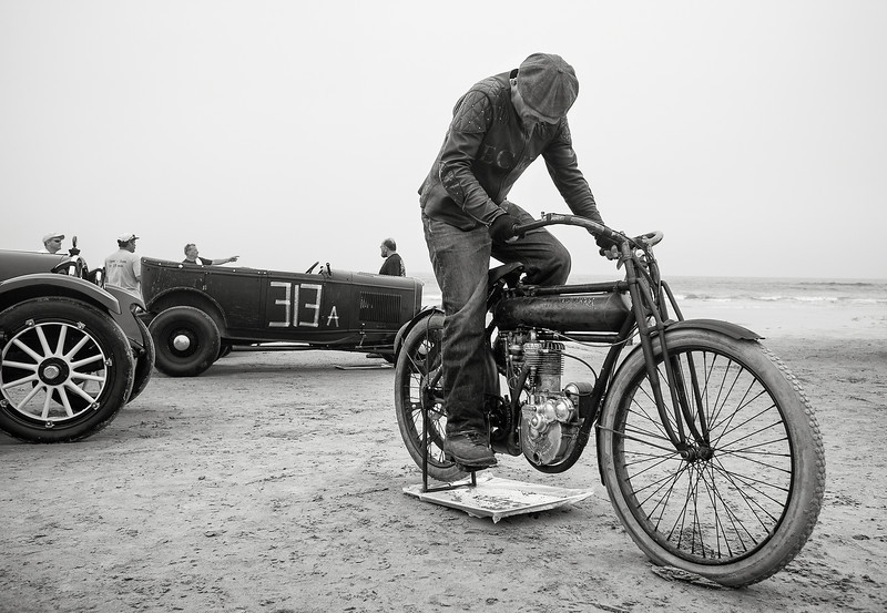 Jeff Decker starts his 1912 Flying Merkel.