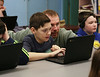 HOLLY PELCZYNSKI - BENNINGTON BANNER  Fifth grade teacher Taylor Robinson helps his student Van Gosseling with coding during the hour of code, at Pownal Elementary School in Pownal Vermont.