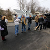 Jean Mitchell the owner of a house at 90 Sylvan Avenue in Leominster was fighting to have an auction on her home stop on Wednesday, January 10, 2019. People wait in the street infront of the house for the auction to start. SENTINEL & ENTERPRISE/JOHN LOVE