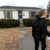 Jean Mitchell the owner of a house at 90 Sylvan Avenue in Leominster was fighting to have an auction on her home stop on Wednesday, January 10, 2019. Mitchell is on the phone trying to get the auction stopped. SENTINEL & ENTERPRISE/JOHN LOVE