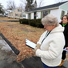 Jean Mitchell the owner of a house at 90 Sylvan Avenue in Leominster was fighting to have an auction on her home stop on Wednesday, January 10, 2019. One of the auctioneers reeds some paper work just before the auction was to start. Just behind her is the oner of the house Jean Mictchell. SENTINEL & ENTERPRISE/JOHN LOVE