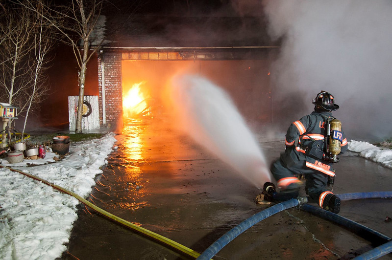 Loveland Fire Rescue Authority firefighters work on a house fire on the 2200 block of Ulmus Drive in east Loveland Wednesday, Dec. 2, 2015. No one was injured in the fire. (Courtesy of Loveland Fire Rescue Authority)