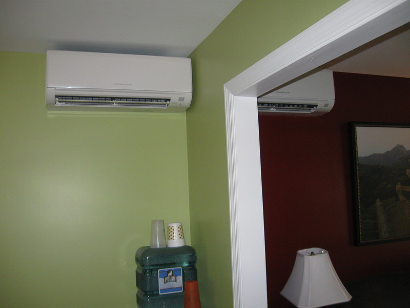 Mr. Slim air handler units in the dining room and living room.