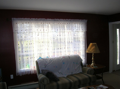 New curtains in the red room.