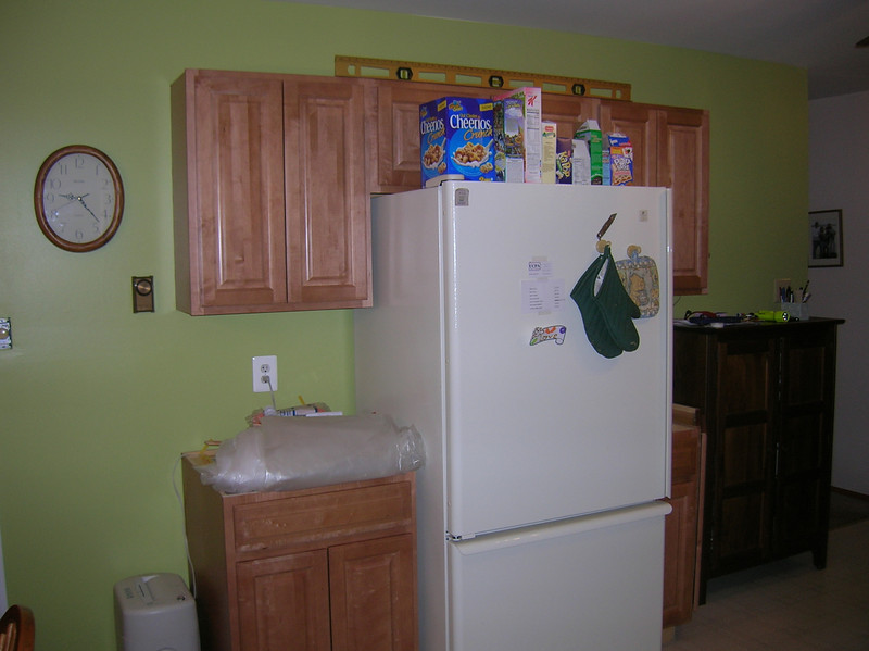 Phase 1 complete:  cabinets hung and refrigerator moved.