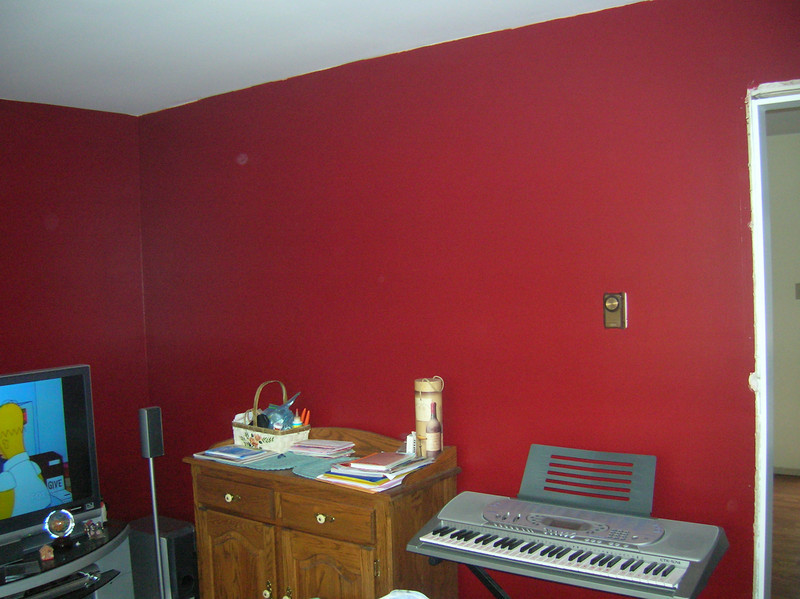 Red room with white doorjambs and trim.  White crown molding is next.