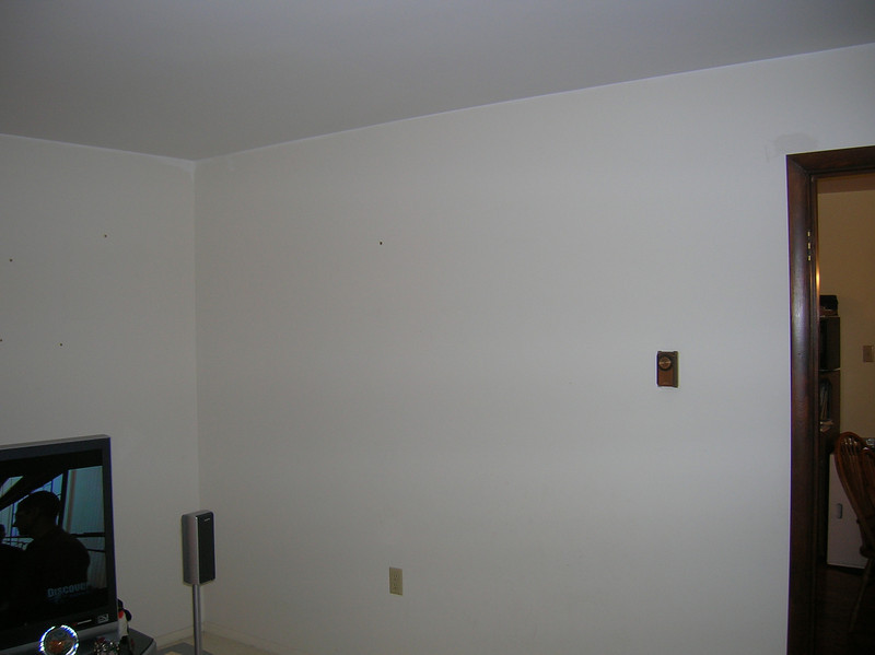 Boring white walls with dark stained doorjambs.  Yawn.