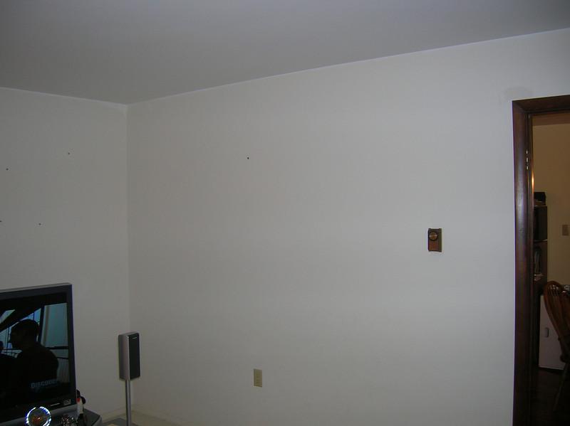 Boring white walls with dark stained doorjambs.  Yawn.