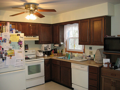 The original 1980 kitchen:  five upper cabinets, two lower cabinets, four narrow drawers and very little counter space.