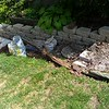 Before - rotting landscape timbers with white pebbles and large stepping stones.  After - block & brick.