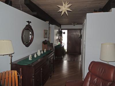 Hallway leading from living room to front door.