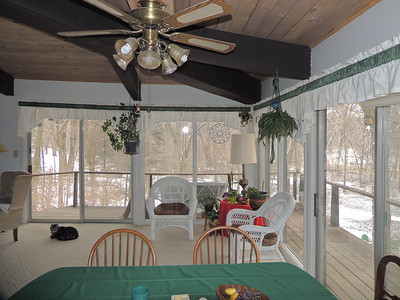 Dining area.  Note wrap around upper level deck.